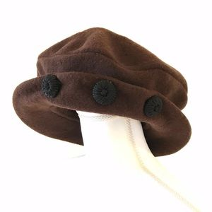 Brown wool hat with velvet band, black buttons